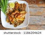 pad thai shrimp in white plate... | Shutterstock . vector #1186204624