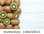 kiwi fruits on white wooden... | Shutterstock . vector #1186218211