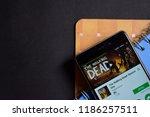 Small photo of BEKASI, WEST JAVA, INDONESIA. SEPTEMBER 23, 2018 : The Walking Dead: Season One dev app on Smartphone screen. The Walking Dead is a freeware web browser developed by Telltale Games