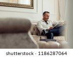 handsome mature businessman... | Shutterstock . vector #1186287064