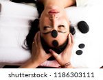 head and face massage with... | Shutterstock . vector #1186303111