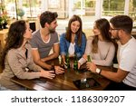 a group of friends at the bar... | Shutterstock . vector #1186309207