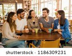 a group of friends talking and... | Shutterstock . vector #1186309231
