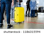 tourists with big yellow... | Shutterstock . vector #1186315594