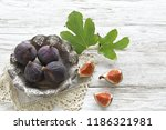ripe figs with leaves  on metal ... | Shutterstock . vector #1186321981