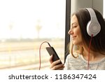 happy commuter traveling into a ... | Shutterstock . vector #1186347424