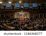 Small photo of Washington, DC., USA, January 3, 2017 Members of the 115th congress and their familes mingle on the house floor while attending the joint session on the opening day of the current session.