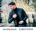 one handsome young man in urban ... | Shutterstock . vector #1186370344