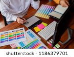 Stock photo graphic design and color swatches and pens on a desk architectural drawing with work tools and 1186379701