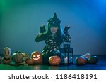 baby girl in a witch costume... | Shutterstock . vector #1186418191