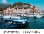 fishing boats moored near... | Shutterstock . vector #1186443817