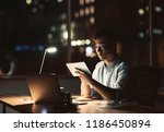 young asian businessman using a ... | Shutterstock . vector #1186450894