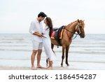 young couple goes honeymoon... | Shutterstock . vector #1186454287