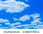 white fluffy clouds in a deep... | Shutterstock . vector #1186455811