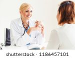 woman doctor is talking and...   Shutterstock . vector #1186457101
