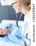 doctor and patient discussing... | Shutterstock . vector #1186530847