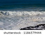 frothy foaming white backwash... | Shutterstock . vector #1186579444