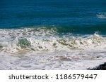 frothy foaming white backwash... | Shutterstock . vector #1186579447