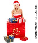 Woman in Santa hat holding gift box. - stock photo
