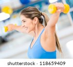 fit woman lifting free weights... | Shutterstock . vector #118659409
