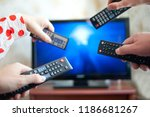 many hands with tv remote... | Shutterstock . vector #1186681267