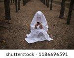 woman in halloween ghost... | Shutterstock . vector #1186696591