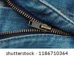 metal zipper on blue shabby... | Shutterstock . vector #1186710364
