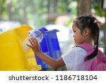 cute asian child girl throwing... | Shutterstock . vector #1186718104