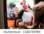 little children trick or... | Shutterstock . vector #1186735984