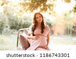pregnant woman wearing stylish... | Shutterstock . vector #1186743301