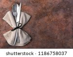 cutlery isolated on a wooden... | Shutterstock . vector #1186758037