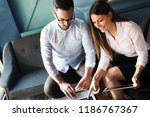 happy colleagues casual chat at ... | Shutterstock . vector #1186767367