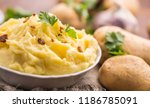 mashed potatoes in bowl... | Shutterstock . vector #1186785091