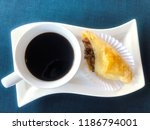hot black coffee on curve... | Shutterstock . vector #1186794001