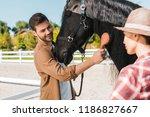 handsome smiling equestrian... | Shutterstock . vector #1186827667