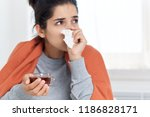 a cold woman napkin in her hand ... | Shutterstock . vector #1186828171