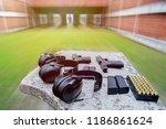 shooting range. gun   bullets ... | Shutterstock . vector #1186861624