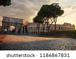 the colosseum and the triumphal ... | Shutterstock . vector #1186867831