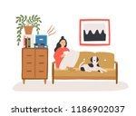 young woman sitting on cozy... | Shutterstock .eps vector #1186902037