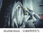 car wheel and tires cleaning... | Shutterstock . vector #1186905571