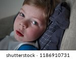 ailing sad little boy with... | Shutterstock . vector #1186910731