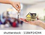 hand giving set of house keys | Shutterstock . vector #1186914244
