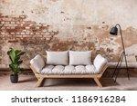 grey wooden sofa between plant... | Shutterstock . vector #1186916284