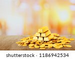 gold bars and coins on... | Shutterstock . vector #1186942534