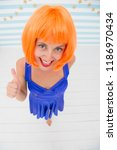 crazy girl showing thumb up... | Shutterstock . vector #1186970434