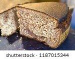 a cut piece of homemade rye... | Shutterstock . vector #1187015344