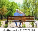 mature couple resting in park... | Shutterstock . vector #1187029174