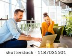 two colleagues sitting in... | Shutterstock . vector #1187035501