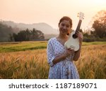 asian woman with ukulele in... | Shutterstock . vector #1187189071