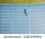 female sprinter running on... | Shutterstock . vector #1187199454